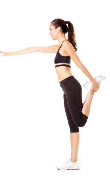 side-portrait-of-young-asian-woman-doing-yoga-exercise-against-isolated-white-background.jpg
